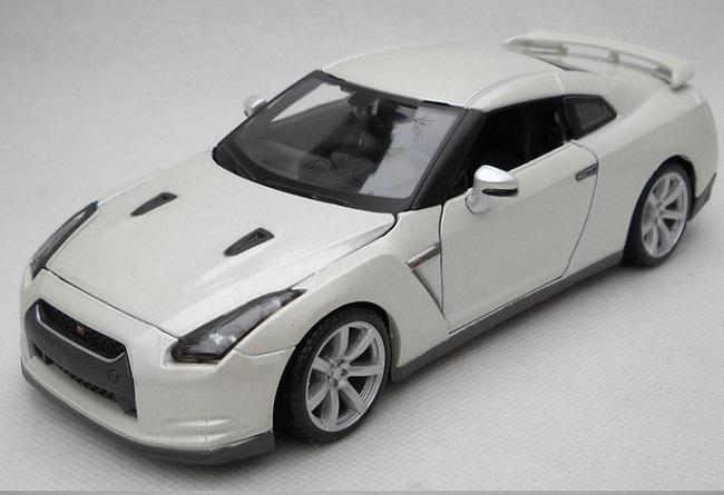 ขาย pre order โมเดลรถเหล็ก โมเดลรถยนต์ Nissan Ares 2009 ขาว 1:24 มี โปรโมชั่น